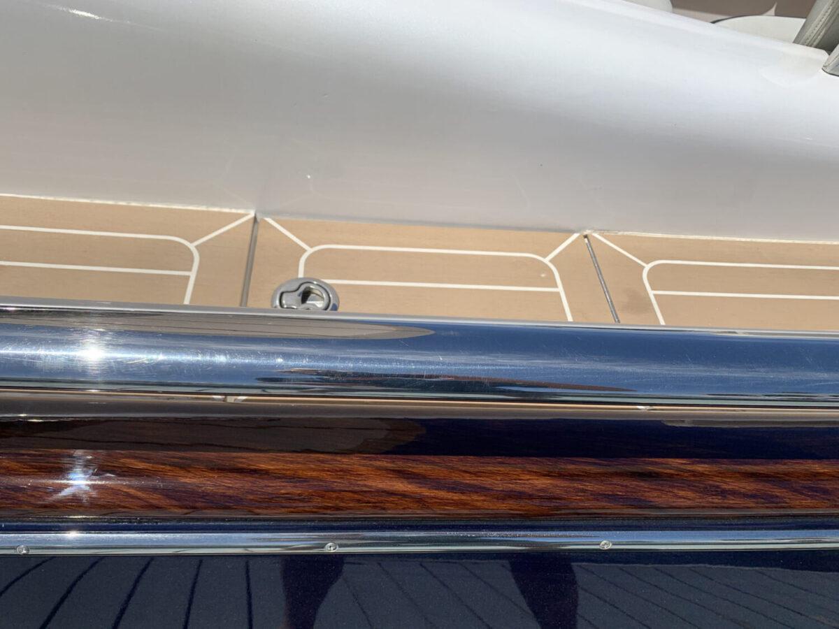 Faux wood grain with Awlgrip clear. Can last 8-10 years!